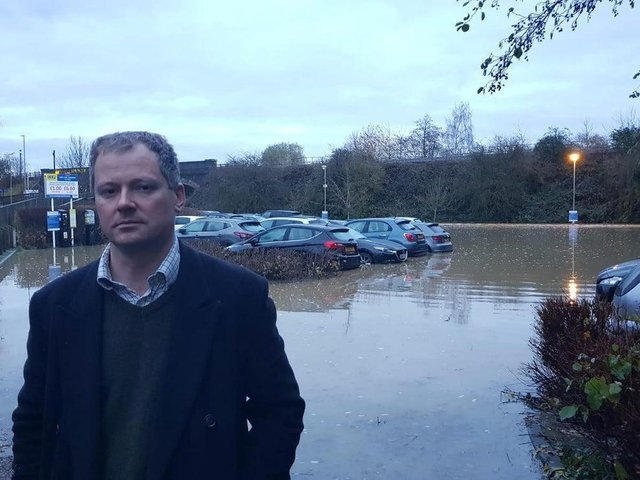 Neil O'Brien MP at the flooded car park.