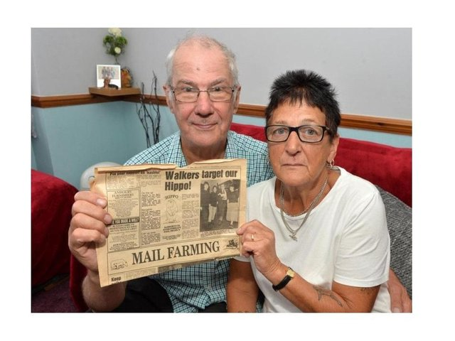 Carole Tilley with her husband Allan, holding an old story about the Hippo Appeal.