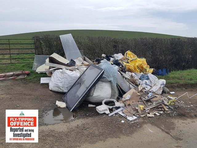 The offenders stacked up this pile of domestic and building waste by a farmfield gate on Allexton Road, Hallaton, near Market Harborough.