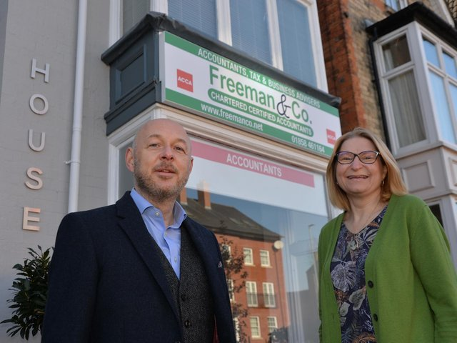 Jonathan and Ruth Freeman outside Freeman and Co's new office in St Mary's Road, Market Harborough.