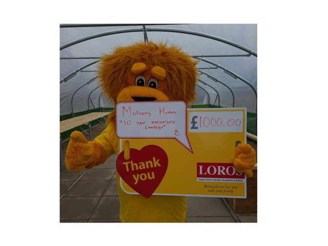 Lionel the Lion, LOROS' mascot, in front of the Poly Tunnel.
