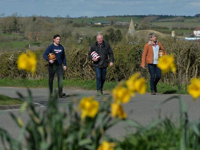 From left, Harry Hollis, Phil Allan chairman and Steve Wickham head towards the bottle kicking battlefield. PICTURE: ANDREW CARPENTER