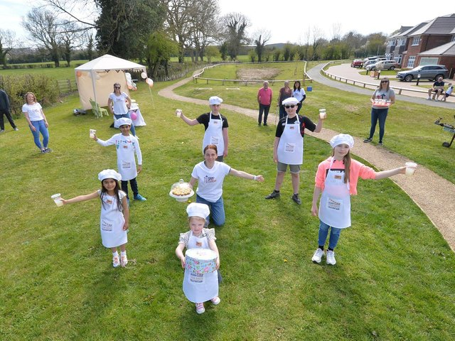 Centre, organiser Charlotte Smith with junior bakeoff youngsters during the Stand Up For Cancer event on Berry Close in Great Bowden on Sunday. PICTURE: ANDREW CARPENTER