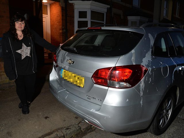 Angry...Amy Bradshaw with her vandalised car after the attack on Caxton Street on Saturday evening. PICTURE: ANDREW CARPENTER