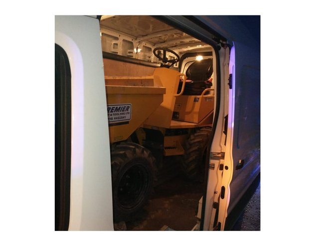 The stolen dumper truck was found by police jammed into the back of a van they stopped in Nottinghamshire.
