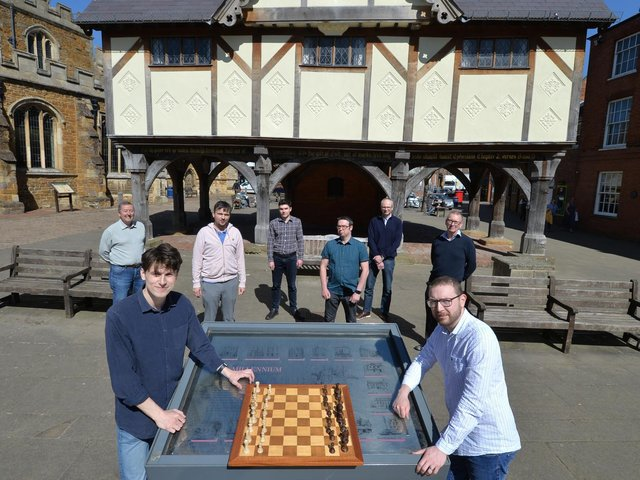 Alistair Geear (left) and Jon Redding at the chess board in front of fellow Harborough Cuatro members (from left) John Thomson, Rene Butler, Mark Waterfield, Mike Garland, Robert Gibbison and Dave Walker. Picture by Andrew Carpenter