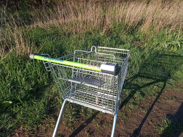 Thieves have randomly dumped a Co-operative shopping trolley in a farmer's field in Market Harborough.