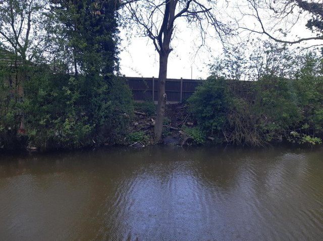 Almost all of the rubbish dumped just feet away from the Greenacres travellers' site on the banks and towpath of the Grand Union Canal has now been removed.