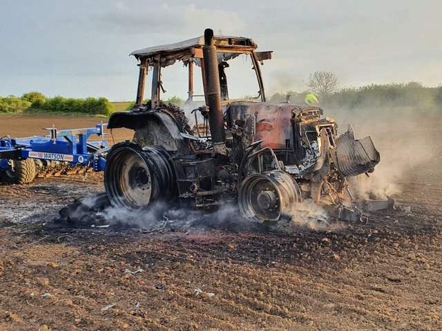 A tractor driver escaped uninjured after their vehicle burst into flames as they ploughed a field near Tugby.