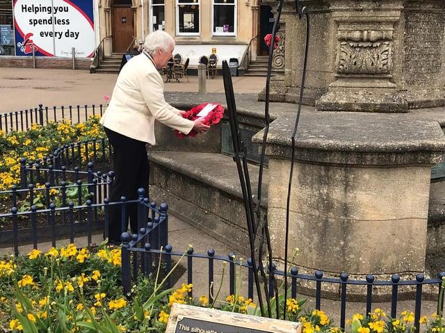 Market Harborough Royal British Legion president Barbara Johnson lays a wreath to celebrate a 100 years.