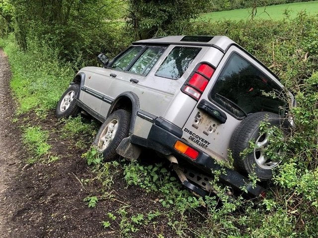Police were called out after this Land Rover Discovery ended up in a ditch on a country road near a Harborough village.