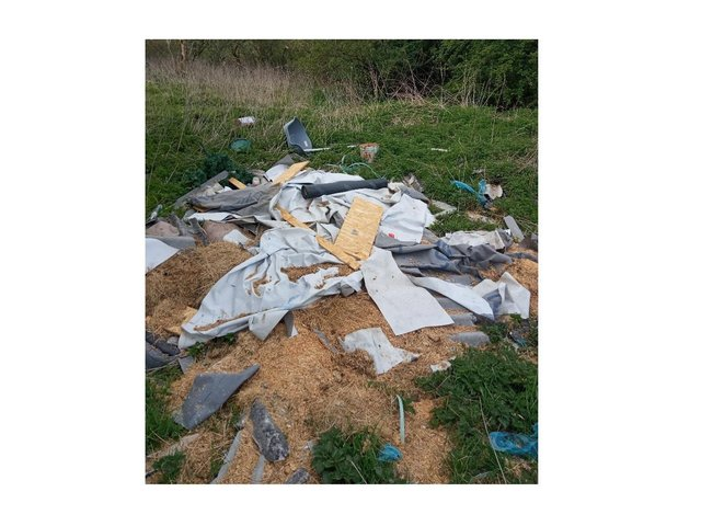 Rubbish dumped in a picturesque meadow near Market Harborough has still not been cleared away – almost a month after the alarm was raised.