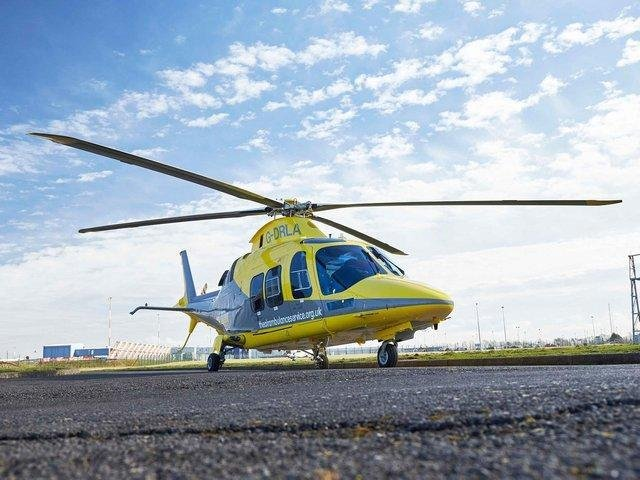 A seriously-injured woman cyclist was rushed to hospital by air ambulance after she was hit by a van in a village near Fleckney.