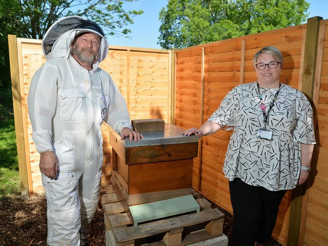 Bee keeper Jak Law and Simone Harrison, deputy head at Farndon Fields Primary School, with their newly installed bee hive. PICTURE: ANDREW CARPENTER