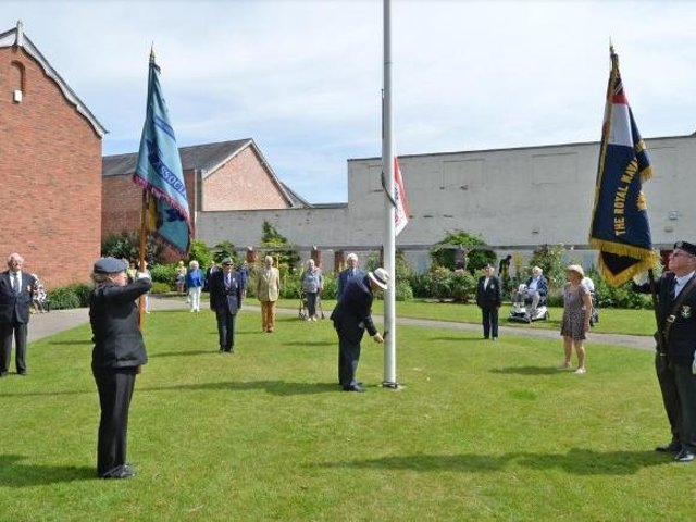 How people marked Armed Forces Day last year (2020). Rev John Morley raises the Armed Forces Flag in the Memorial Gardens. PICTURE: ANDREW CARPENTER