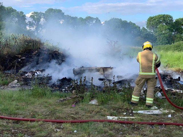 Arsonists torched a massive pile of fly-tipped rubbish twice in three hours in Desborough last night – keeping firefighters at full stretch.