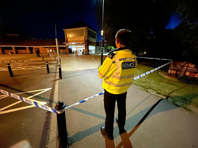 Police cordon off the scene at Sainsbury's. Photo by Andrew Carpenter.