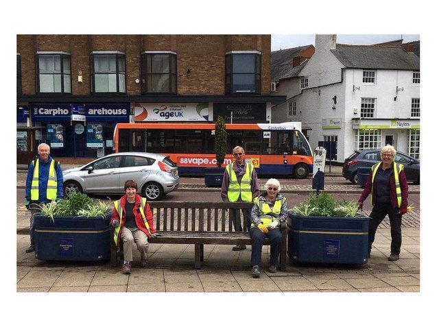 Harborough in Bloom volunteers with the floral displays - before they were stolen.