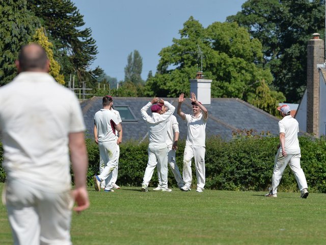 Market Harborough's Nick Hall celebrates taking a catch to dismiss Dan Scudamore during their 85-run defeat to Haughton & Thurnby in Division Two. Picture by Andrew Carpenter