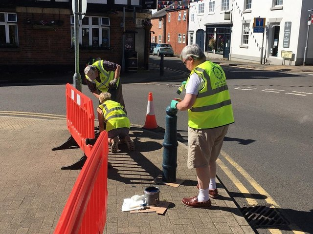 Six Rotarians at Lutterworth Rotary Club got behind the council to paint the eight bollards that stand nearby the memorial.