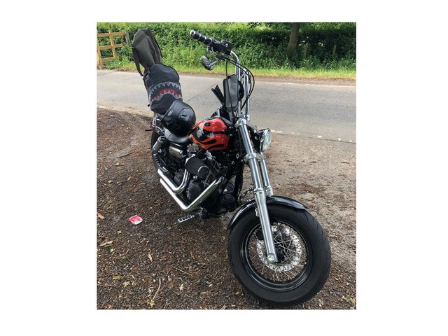 A banned motorcyclist in the Harborough district who crashed into the back of a car with children passengers in the vehicle has had his machine seized.