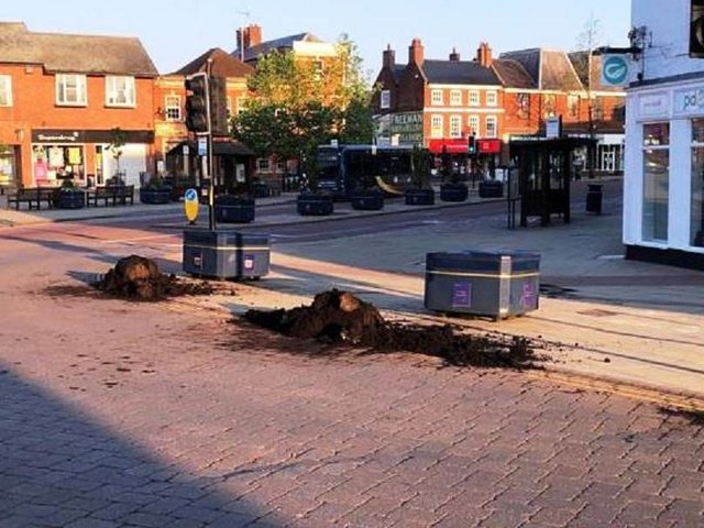 Vandals have wrecked stunning floral displays and left a trail of damage in Market Harborough town centre last night (Tuesday).