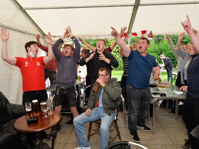 Fans celebrate England's victory against Germany at the Royalist in Market Harborough.