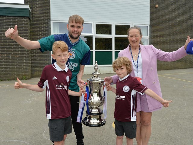 Adam Cruickshank (PE teacher) and Sarah Hubbard (finance) with Lucas and Henry Williams who were at Wembley. PICTURE: ANDREW CARPENTER