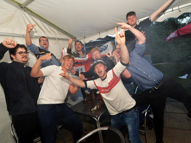Fans celebrate the England victory at the Royalist pub on Western Avenue in Market Harborough.