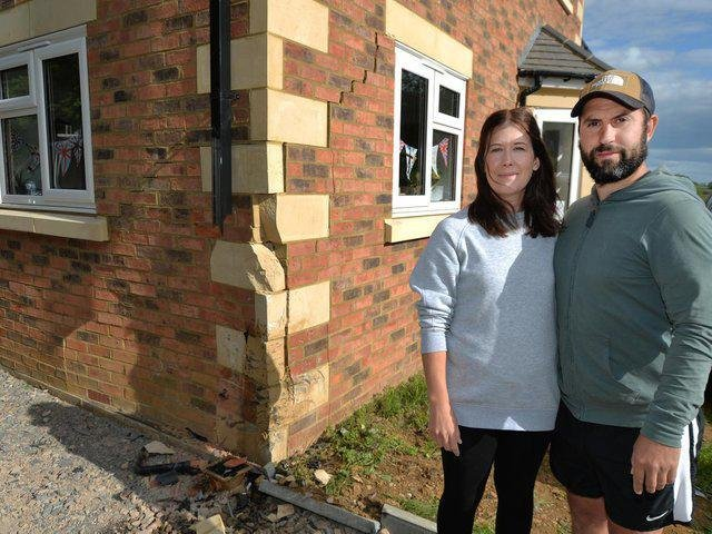 Jack Walther and his wife Katie survey the damage to their house after the crash.