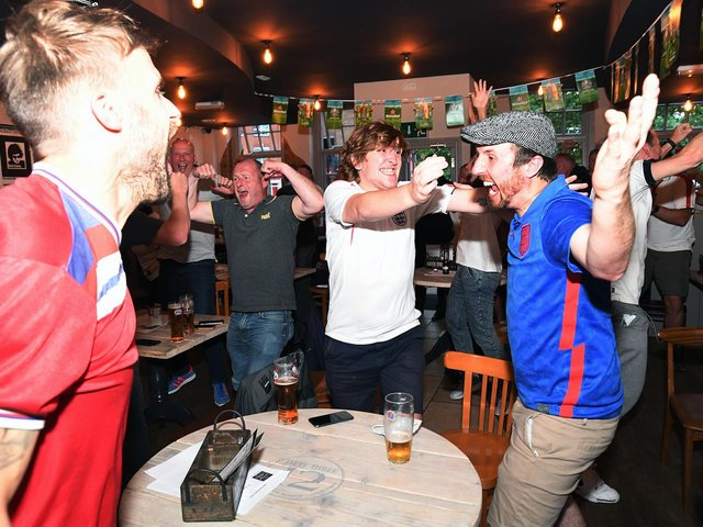 Joy as England fans celebrate drawing level with Denmark at Bar Fifty Three on The Square.